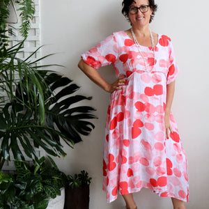Good Day Sunshine below the knee women's summer dress. Fully lined in a lightly textured fabric with side seam pockets. A Race Day ready style or any special occasion.
