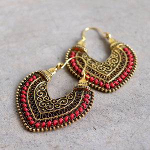 Brass filigree earrings with linen thread colour wrap details. Heart-Red.