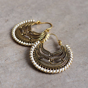 Brass filigree earrings with linen thread colour wrap details. Moon-Flower-White.