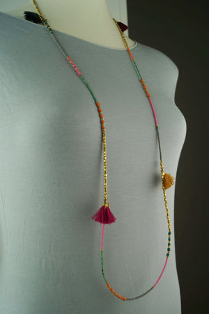 Long multi-coloured beaded necklace with colourful tassel fixtures.