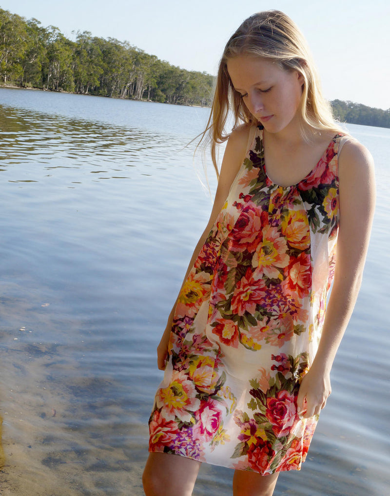 Here Comes the Sun Dress. Ethically produced light cotton knee-length dress. Floral white and peach.