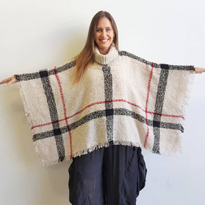 Warm winter women's Poncho, with thick and soft roll-neck top. Easy throw on one-size knit, in a classic striped print. Made with no itch acrylic. Oyster.