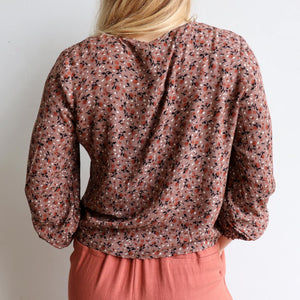 Honey Honey long sleeve blouse, great floral print women's top for work or casual wear. True to size fit with a tie front at the hem. Made with easy care rayon. Dusk.