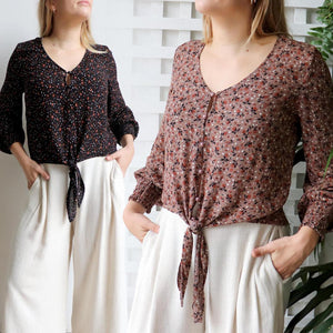 Honey Honey long sleeve blouse, great floral print women's top for work or casual wear. True to size fit with a tie front at the hem. Made with easy care rayon.