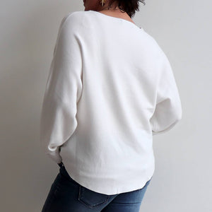 Horizons Knit Batwing Relaxed Fit Sweater is a  cozy, slouch style winter jumper. Winter White. Back view.