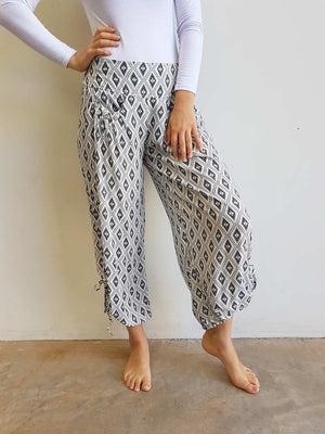 Light + floaty cool rayon harem pant with drawstring ties + front button feature pockets in Ikat Print. Available in navy + white, sizes 8 - 18.