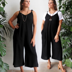 Casual summer jumpsuit in loose fitting style and adjustable shoulder tie straps. Plus size available. Black.