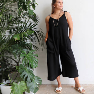 In Cahoots Jumpsuit - Classic black overalls designed for small to plus sizes. Front pockets view.