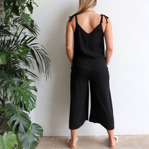 In Cahoots Jumpsuit - Classic black overalls designed for small to plus sizes. Back view.