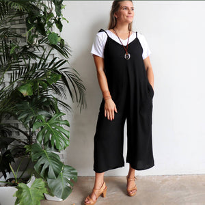In Cahoots Jumpsuit - Classic black overalls designed for small to plus sizes. Layered with t-shirt view.