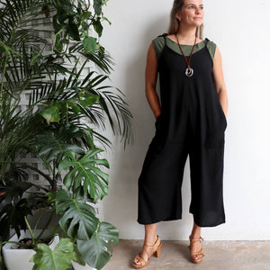 In Cahoots Jumpsuit - Classic black overalls designed for small to plus sizes. Layered with black tshirt.