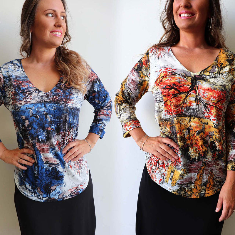 V-neck long sleeve printed women's tshirt with artistic print in cobalt blue and rust orange.