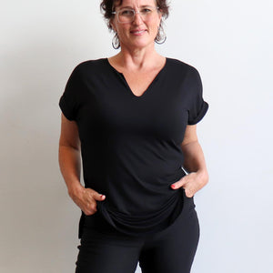 In The Moment T-shirt made in bamboo is the short-sleeved women's basic top. Black pockets view.