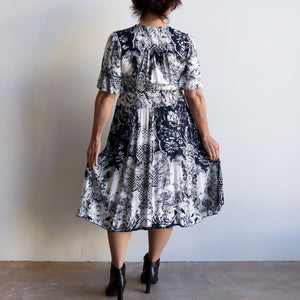The Isabelle dress is a smart-casual, short sleeve dress in an elegant navy blue print and below-the-knee hemline