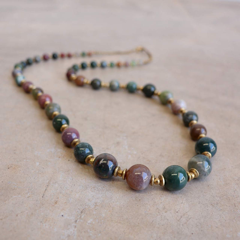 Gorgeously hand knotted + crafted stone + brass graduated bead necklace. Made with quality materials + beautiful finish.  Forest Green Stone.