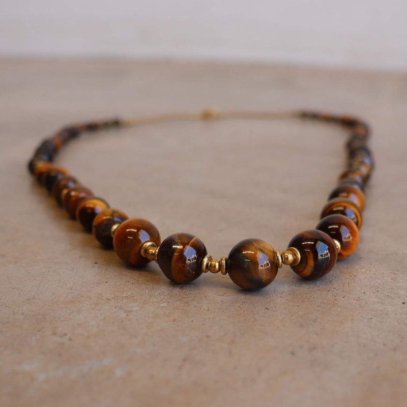Gorgeously hand knotted + crafted stone + brass graduated bead necklace. Made with quality materials + beautiful finish.  Tigers Eye.