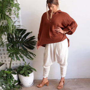 Pure Italian linen women's blouse. Summer top features a mother-of-pearl button feature on the back and roomy cut to sleeves. Available in sizes M-XL. Chestnut.