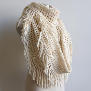 Soft knit Infinity Scarf created from acrylic fibre is a cosy wardrobe addition perfect for winter outfits. Versatile and comfortable to wear, it measures 180cm around. Cream.