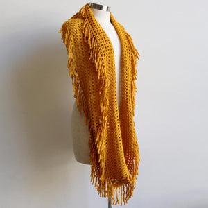 Soft knit Infinity Scarf created from acrylic fibre is a cosy wardrobe addition perfect for winter outfits. Versatile and comfortable to wear, it measures 180cm around. Mustard Yellow.