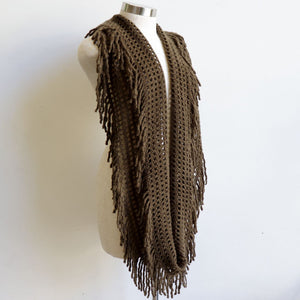 Soft knit Infinity Scarf created from acrylic fibre is a cosy wardrobe addition perfect for winter outfits. Versatile and comfortable to wear, it measures 180cm around. Olive Green.