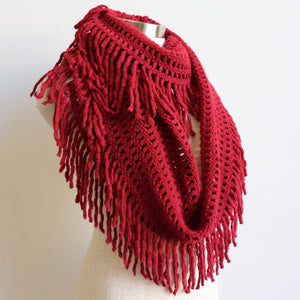 Soft knit Infinity Scarf created from acrylic fibre is a cosy wardrobe addition perfect for winter outfits. Versatile and comfortable to wear, it measures 180cm around. Red.