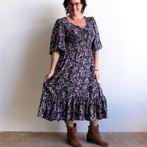 Jessie's Girl Midi Dress is a romantic floral design with all the retro romance of a classic boho style. Navy Blue. Skirt view.
