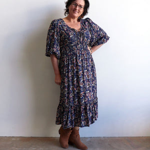 Jessie's Girl Midi Dress is a romantic floral design with all the retro romance of a classic boho style. Navy Blue. Pockets.