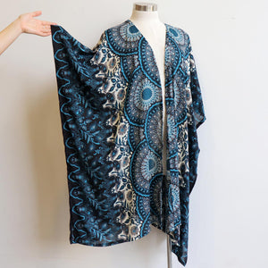 Our versatile & lightweight Kimono Wrap is made from a cotton feel rayon fabric. The Dreaming print Kimono can be added to any outfit & generously cut to fit all sizes. Navy Blue.