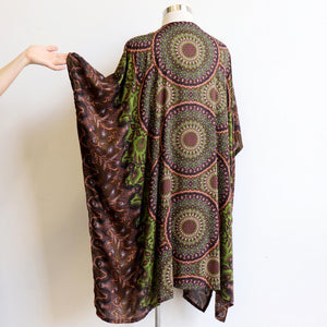 Our versatile & lightweight Kimono Wrap is made from a cotton feel rayon fabric. The Dreaming print Kimono can be added to any outfit & generously cut to fit all sizes. Olive Green.