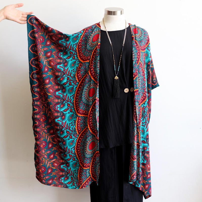 Our versatile & lightweight Kimono Wrap is made from a cotton feel rayon fabric. The Dreaming print Kimono can be added to any outfit & generously cut to fit all sizes.