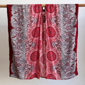 Versatile & lightweight wrap made in a vibrant rayon fabric. Free size garment with a flatlay width of 110cm. Burgundy.