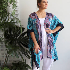 Versatile & lightweight wrap made in a vibrant rayon fabric. Free size garment with a flatlay width of 110cm. Sky Blue.