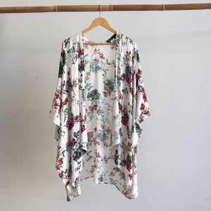 Kimono Kaftan open front women's cardigan. Plus Size styling in a floral print with Vintage White.