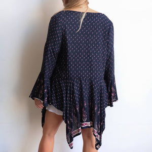 Kindred Spirits Cardi in Karma Collection navy and pink floral print. Long fluted sleeves. Sizes 10 to 20 available.