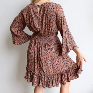 Knowing Me Dress a blouse style bodice dress. An all-seasons women's dress with full sleeves and rear elasticated waistband with ruffled hemline. True to size fit in sizes 8-16. Dusk.