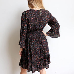 Knowing Me Dress a blouse style bodice dress. An all-seasons women's dress with full sleeves and rear elasticated waistband with ruffled hemline. True to size fit in sizes 8-16. Midnight.