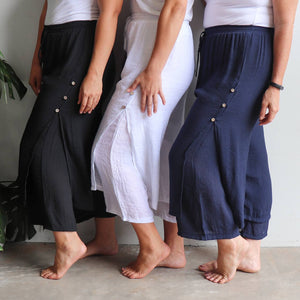 Women's double layered drawstring pants with wide leg and button feature. Lightweight spring to summer pants in a semi-sheer textured linen look fabric. Great for tropical travel and casual floaty beach look. Plus sizes available up to a size 20.