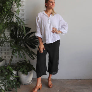Women's double layered drawstring pants with wide leg and button feature. Lightweight spring to summer pants in a semi-sheer textured linen look fabric. Great for tropical travel and casual floaty beach look. Plus sizes available up to a size 20 - Black