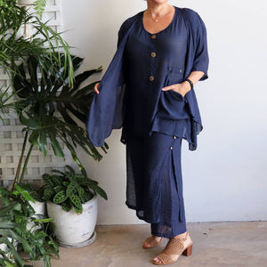 Women's double layered drawstring pants with wide leg and button feature. Lightweight spring to summer pants in a semi-sheer textured linen look fabric. Great for tropical travel and casual floaty beach look. Plus sizes available up to a size 20 - Navy Blue