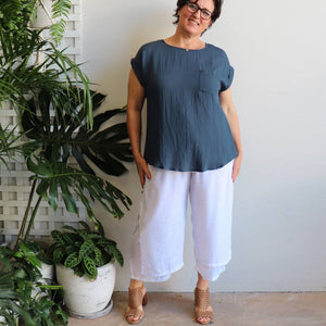 Women's double layered drawstring pants with wide leg and button feature. Lightweight spring to summer pants in a semi-sheer textured linen look fabric. Great for tropical travel and casual floaty beach look. Plus sizes available up to a size 20 - White