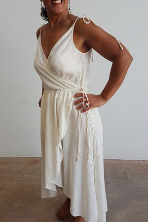 100% cotton spaghetti strap summer boho wrap dress with adjustable ties. Natural white.