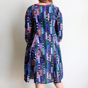 Handmade long sleeve cotton dress in vibrant patchwork print. Below the knee hemline and full-skirt shape. Sizes S to XXXL available. Limited edition.