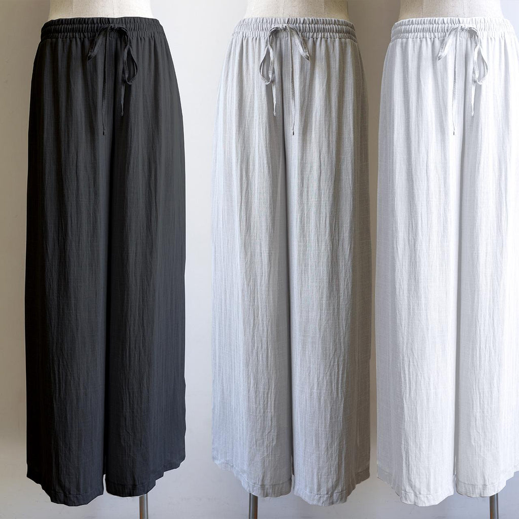 Elastic waist long lounge pant in softly flowing linen blend fabric with a luxe feel.