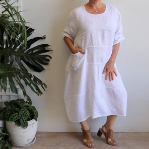 Women's white Italian linen kaftan dress. Roomy summer dress with tie back sleeve and front pockets. Free-size garment fitting up to size 18. 100% linen made in Italy.