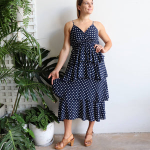 Love Her Layer Dress is a classic feminine style with beautiful ruffled skirt design. A perfect summer dress for race day, picnics or holidays! Navy polkadot