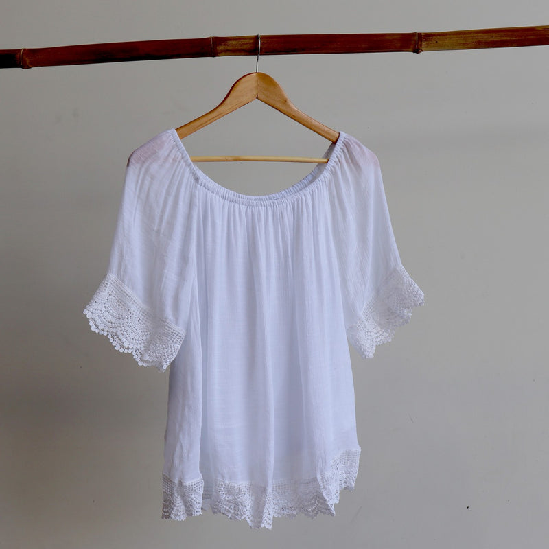 Summer blouse top with 3/4 sleeve and cotton lace trim. Wear it on or off the shoulder for day or evening wear.