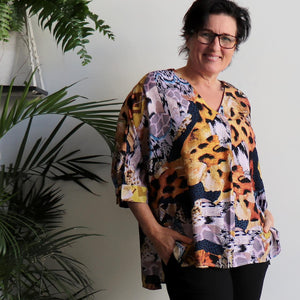 Lucy In The Sky Blouse, a kaftan style summer top in safari animal print. Amber.