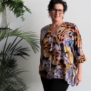Lucy In The Sky Blouse, a kaftan style summer top in safari animal print. Amber front.