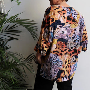 Lucy In The Sky Blouse, a kaftan style summer top in safari animal print. Amber Back.