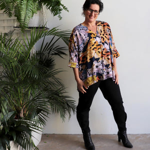 Lucy In The Sky Blouse, a kaftan style summer top in safari animal print. Amber long view.